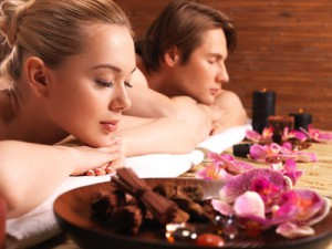 Attractive couple relax at the spa salon. Beauty treatment concept.
